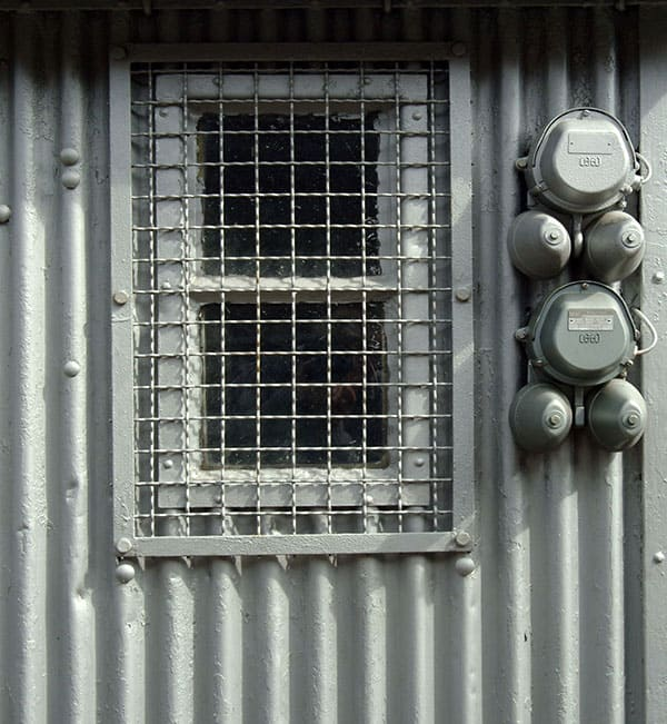 corrugated iron covering shed window