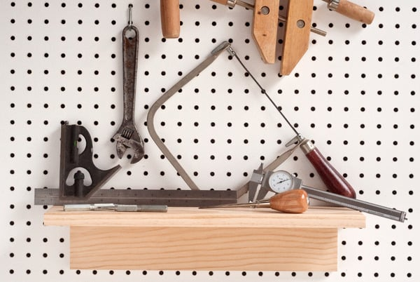 DIY pegboard shelf for garden tool organization