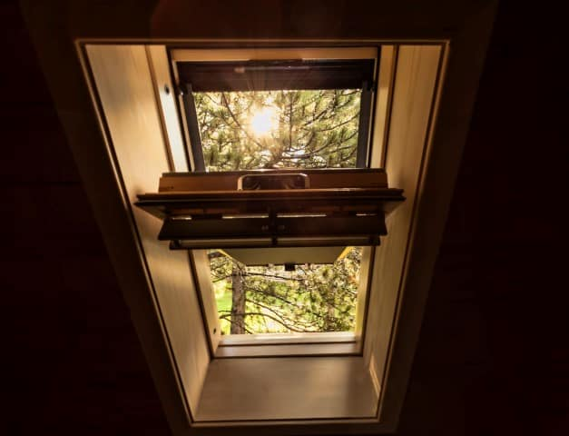 Beautiful nature view through roof skylight Shed skylight