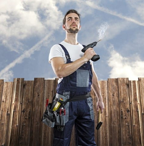 worker ready to start working with a smoking drill bit