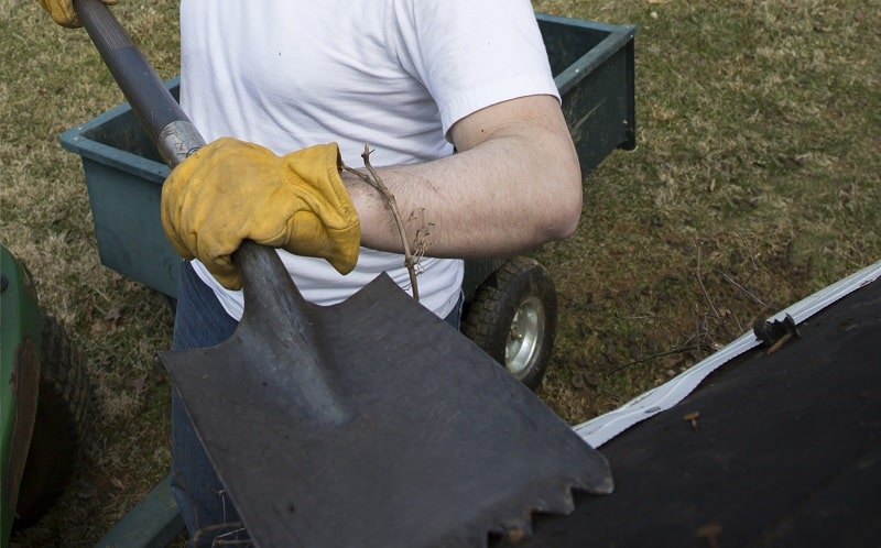 Shed Roof Materials - Man clearing shingles
