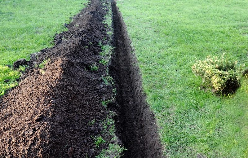 Best Trenching Shovel - A trench dug along lawn