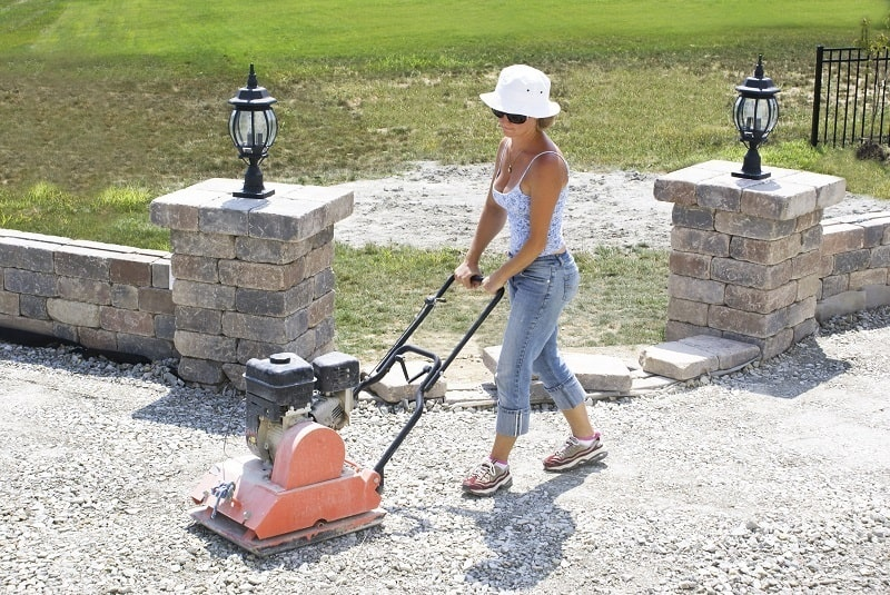 Using a Compactor to compact a gravel driveway